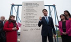 Ed Miliband unveils Labour's pledges carved into a stone plinth in Hastings on Saturday.