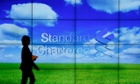 A staff member walks inside a priority banking service area of a Standard Chartered bank in Hong Kong in this August 1, 2012 file photo.