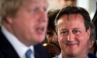 David Cameron listens to Boris Johnson in Hendon, north-west London