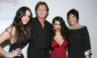 Khloe Kardashian, Caitlyn Jenner before transitioning, Kim Kardashian and Kris Jenner at the premiere of the Keeping Up with the Kardashians in 2007.