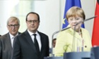 Jean-Claude Juncker, left, François Hollande and Angela Merkel in Berlin. Officials close to the talks between Greece and the troika earlier dismissed rumours of an imminent deal.