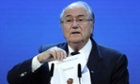 Sepp Blatter holds up the name of Russia during the official announcement of the 2018 World Cup host country.