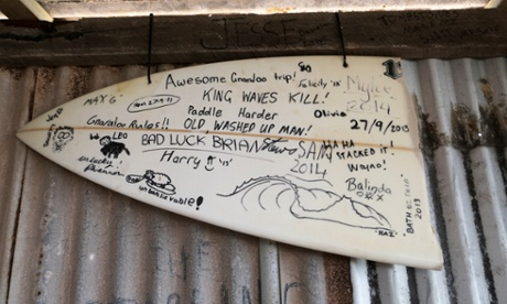 Graffiti on a broken surfboard.