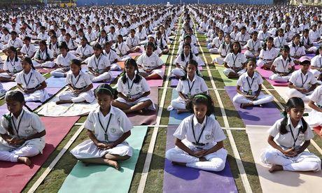 Modi's plan to change India and the world through yoga angers religious minorities