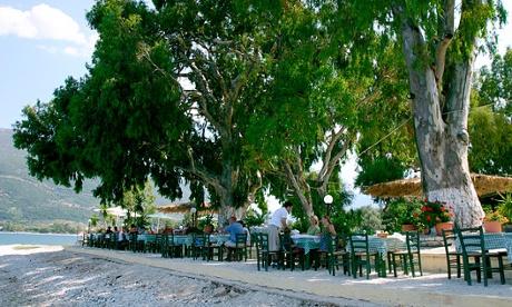Taverna tables at Karavomilos lake, Kefalonia, Greece.
