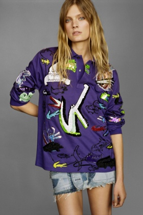 Constance Jablonski wears a Lacoste polo shirt embroidered by Lesage.