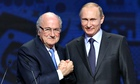 Sepp Blatter shakes hands with Vladimir Putin