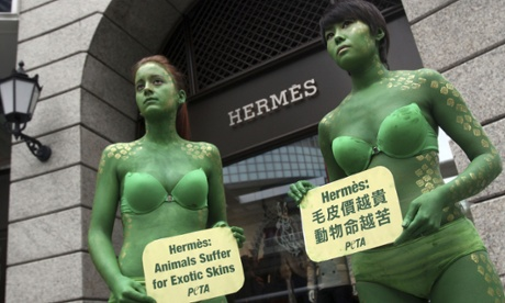 Peta activists protest outside a Hermès store in Taiwan.