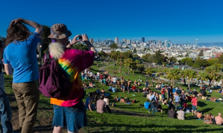 Tourists taking pictures in Dolores Park, San Francisco.