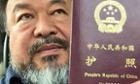 Ai Weiwei's with his recently returned passport.