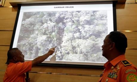 Indonesia plane crash: rescuers reach Papua site and find dozens of bodies