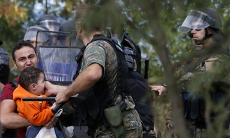 Migrants try to charge Macedonian police lines at Greek border