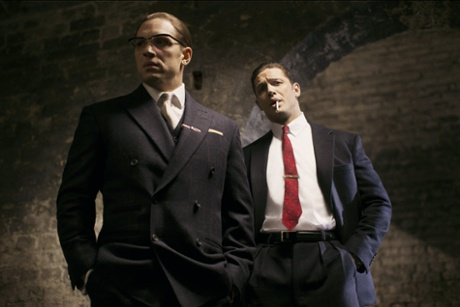 Tom Hardy as Ronnie (with spectacles) and Reggie Kray in Legend.