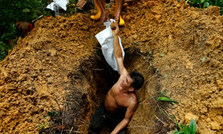 Land-starved Singapore exhumes its cemeteries to build roads and malls