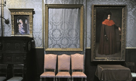 The empty frame, centre, from which thieves cut Rembrandt's Storm on the Sea of Galilee remains on display at the Isabella Stewart Gardner Museum in Boston.