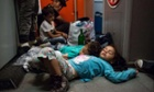 Refugees sleep on a train to Germany