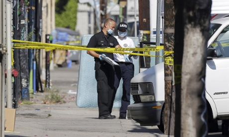 Los Angeles grieves for three brothers found stabbed to death outside school