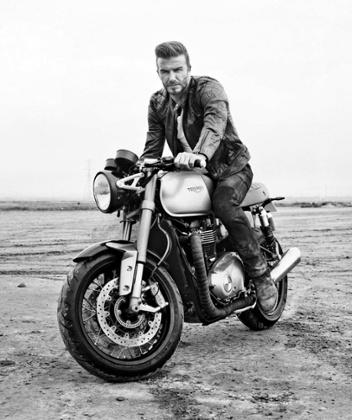 David Beckham sits astride a Triumph bike to model a new Belstaff Outlaws jacket