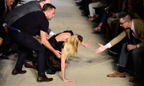 Model Candice Swanepoel takes a tumble on the Givenchy runway.