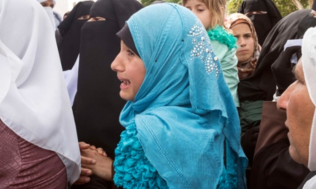 Grief and anger as Palestinian teacher killed in arson attack is laid to rest