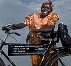 Katine village health team member Betty Ajang with her bike from Amref.