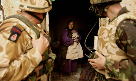 British soldiers visit locals in a village south of Basra in 2003