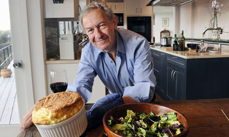 Simon Schama at home making a cheese souffle