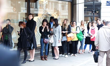 Shoppers wait for H&M in Regent Street, London, to open