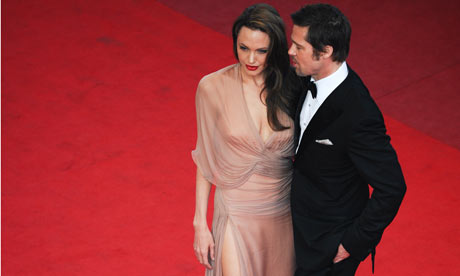 Angelina Jolie and Brad Pitt at Cannes. Photograph: Martin Bureau/AFP/Getty