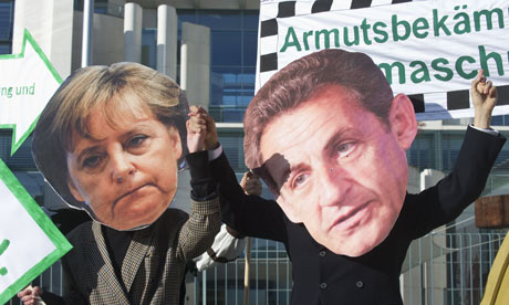 Protesters in Berlin dressed as German chancellor Angela Merkel and French president Nicolas Sarkozy ahead of Sunday's EU summit.
