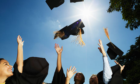 Graduates throw their hats into the air