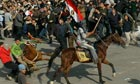 Mubarak supporters on horses in Tahrir Square
