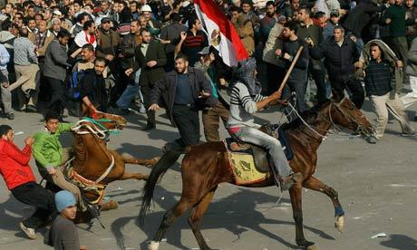 Egypt's revolution turns ugly as Mubarak fights back Mubarak-supporters-on-hor-007
