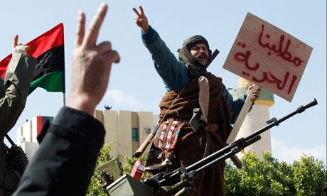 A man stands on a Libyan tank