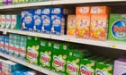 Soap powder products on supermarket shelves