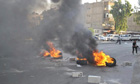 Burning tyres in Damascus