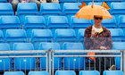 Spectator with umbrella at Queen's tennis tournament