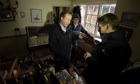 David Cameron talks with a resident in flood affected home in Yalding