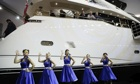 Singers serenade Sunseeker's stand at the London boat show.