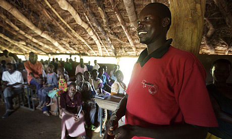 Amref driver Joseph explains the Katine project to church members