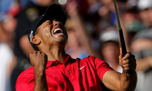 Tiger Woods reacts to his birdie putt on the 18th green to force a playoff with Rocco Mediate during the final round of the US Open