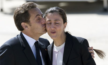France's President Nicolas Sarkozy kisses freed French-Colombian hostage Ingrid Betancourt on arrival at Villacoublay military airport in Paris. Betancourt and 14 others were rescued on Wednesday.
