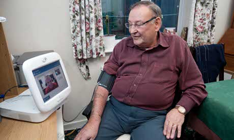 David Ward, a heart patient in Wakefield, using a telehealth monitor