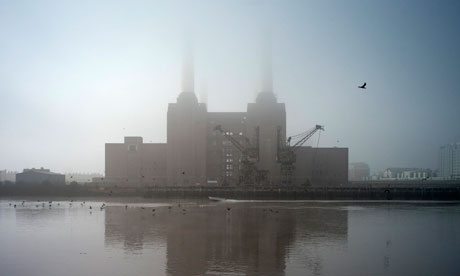 File photo shows Battersea Power Station shrouded in fog on the River Thames in London