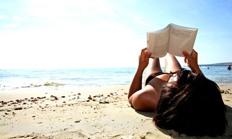 A woman reading on a beach – for Mrs Cameron's Diary