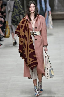 A model wearing a blanket at the Burberry Prorsum ready to wear autumn/winter 2014-15 London fashion