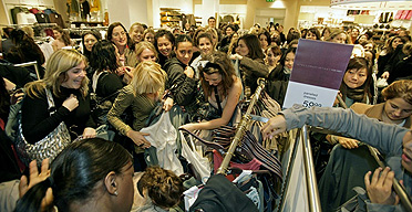 Crowds of shoppers surround Stella McCartney's fashion collection as it premieres at H&M, Oxford Circus