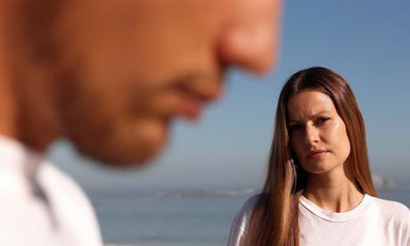 Unhappy couple on a beach