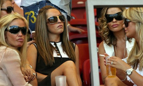 Footballer's wives busy pouting. Photograph: Adrian Dennis/ AFP