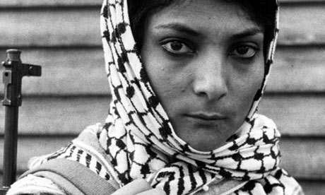 Leila Khaled wearing a keffiyah